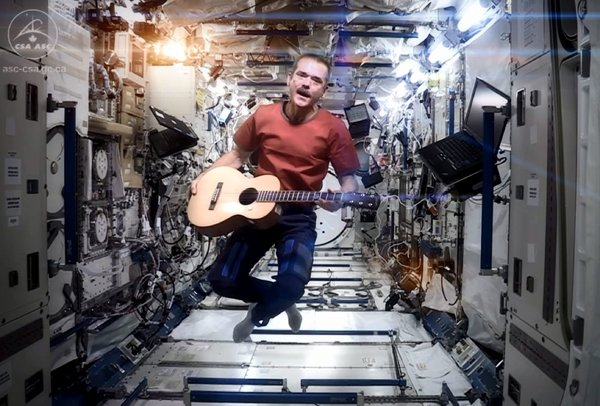 "The Canadian astronaut Chris Hadfield performing a cover of David Bowie's ""Space Oddity"" aboard the International Space Station. The station was set up ""for peaceful purposes"" in 1998. Credit Chris Hadf"